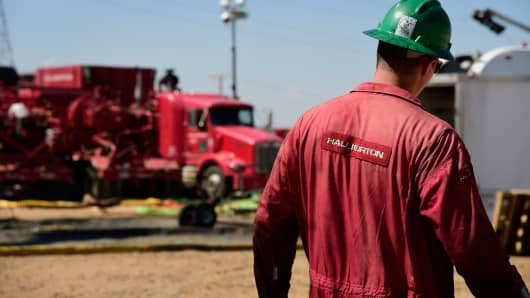 A Halliburton worker walks through a hydraulic fracturing site north of Dacono, Colorado.